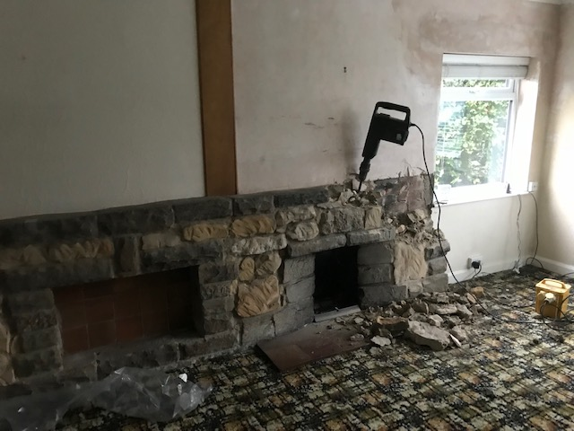 Breaking out the old fireplace